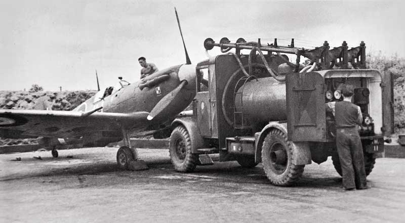 317 squadron spitfire jh-j being serviced by a bowser